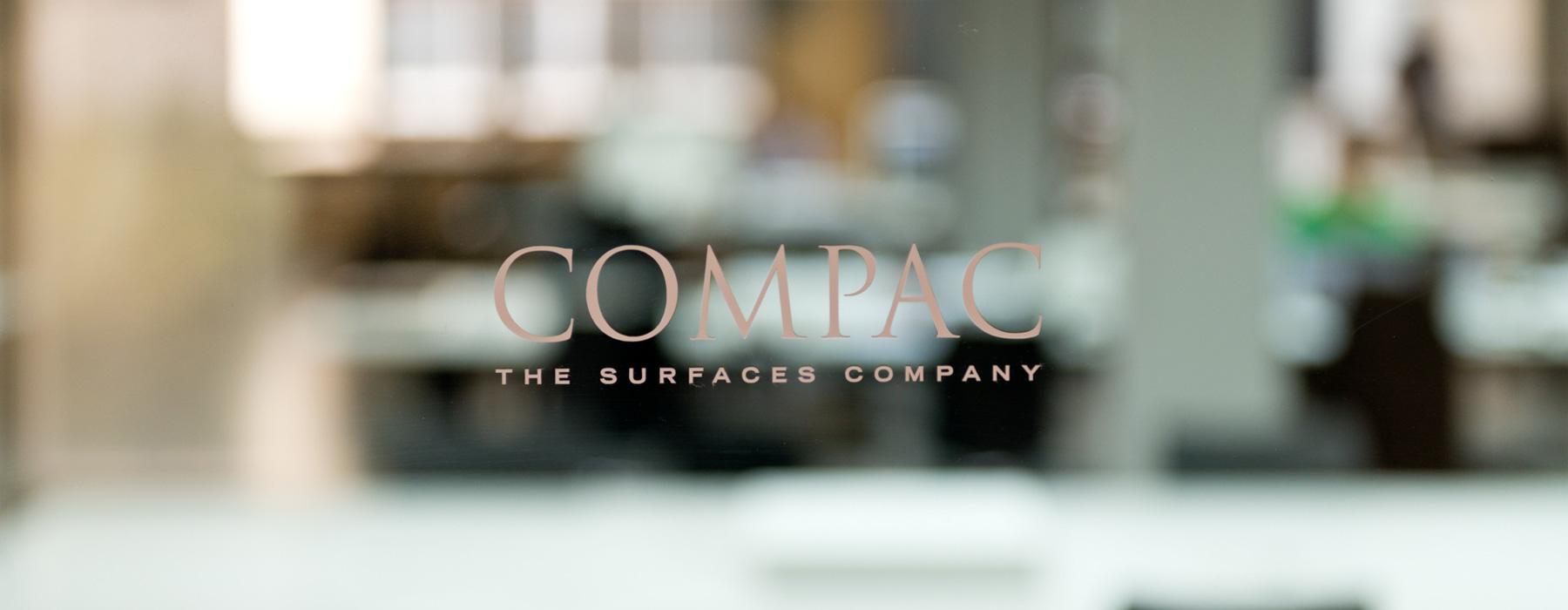 logotipo de MARMOL COMPAC, SA